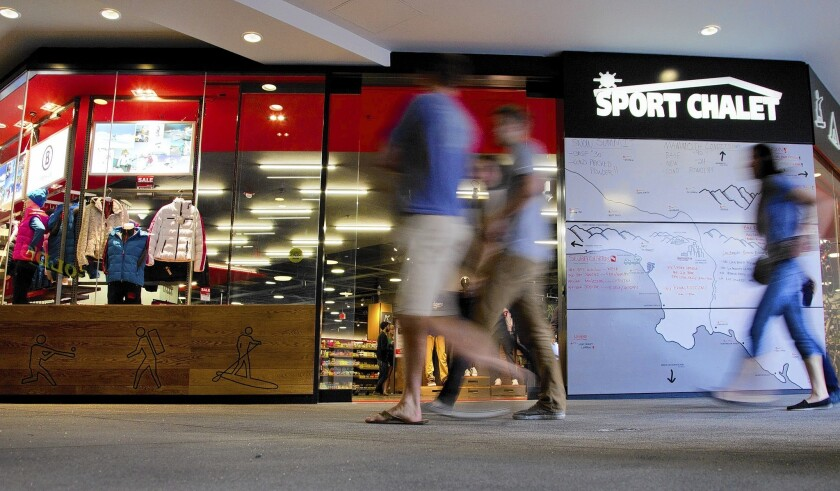 The Sport Chalet at the Figueroa and 7th Street shopping center in downtown Los Angeles posts ski conditions outside during the season. Sport Chalet, started in the foothills of the San Gabriel Mountains, has been sold to an East Coast firm.