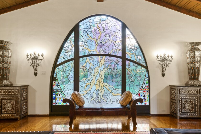 "Built in 1928, the Spanish-style hacienda includes a massive custom stained-glass window called ""Tree of Life."""