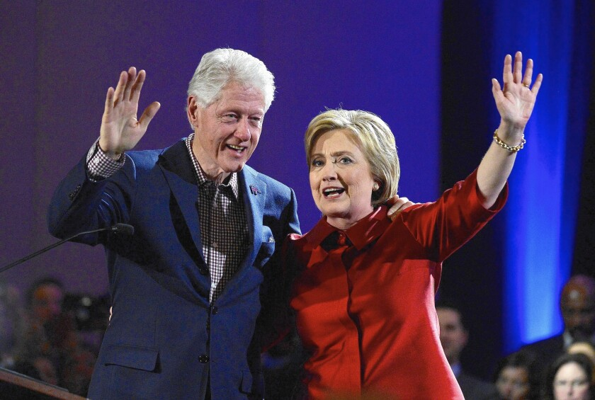 Bill and Hillary Clinton wave to supporters while celebrating Hillary's win in the Nevada caucus at Caesar's Palace Casino in Las Vegas on Feb. 20.