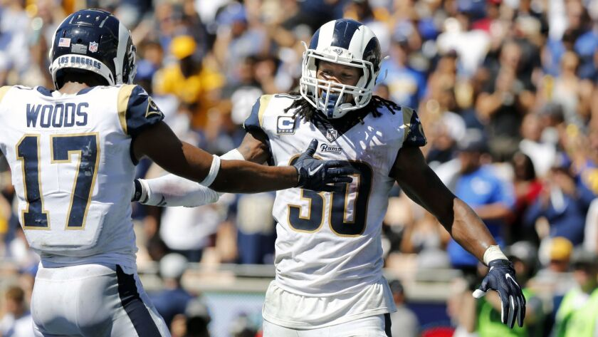 Rams running back Todd Gurley (30) celebrates with Rams wide receiver Robert Woods (17) against the Arizona Cardinals.