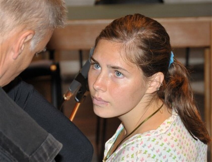 U.S. murder suspect Amanda Knox listens to her lawyer Carlo Dalla Vedova, left, prior to a hearing in the Meredith Kercher murder trial, in Perugia, Italy, Monday, July, 6, 2009. Knox and her former Italian boyfriend, Raffaele Sollecito, are on trial for the murder of Knox's British roommate, student Meredith Kercher, found dead in the house they shared on Nov. 2007. (AP Photo/Stefano Medici)