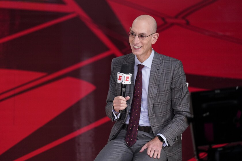 File-This Oct. 4, 2020, file photo shows NBA Commissioner Adam Silver speaking during an interview before the NBA Finals in Lake Buena Vista, Fla. The NBA has informed teams that it intends to return to a normal schedule next season, with training camps opening in late September and the regular season set to begin on Oct. 19., 2021. It is not an unexpected development, and Silver has said several times that the league's intention for the past several months, virus-permitting, was to get the league back onto its regular calendar after two seasons of schedule havoc because of the pandemic. (AP Photo/Mark J. Terrill, File)