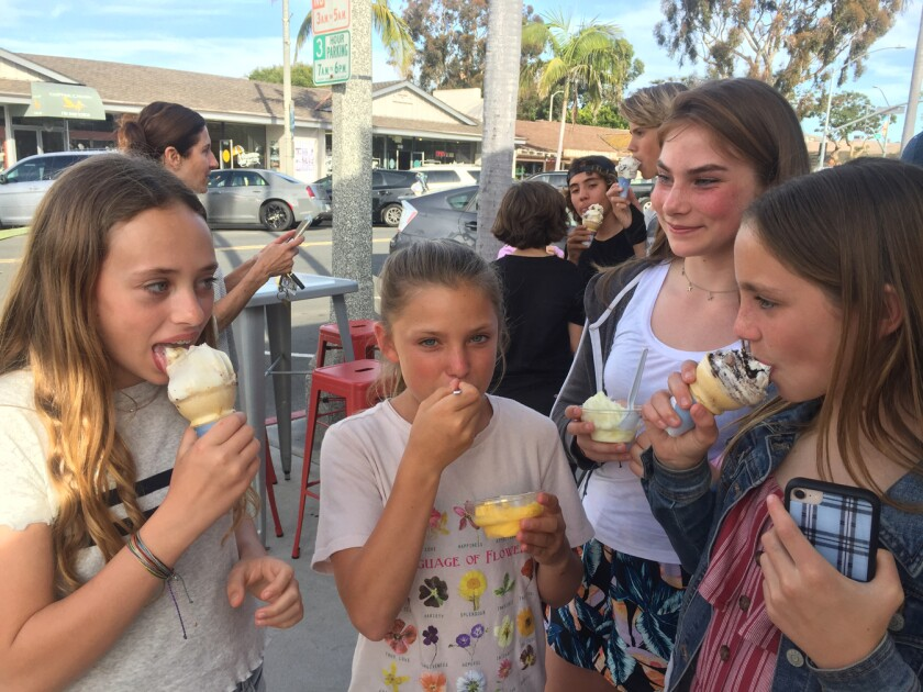 A group of girls sample different flavors at the soft opening of Handel's Homemade Ice Cream in Carlsbad on Monday.