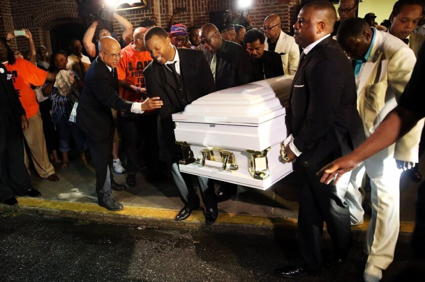 The casket of Eric Garner is carried from his funeral in late July. The death of the 43-year-old man, who was placed in a chokehold by a New York police officer, has been ruled a homicide.