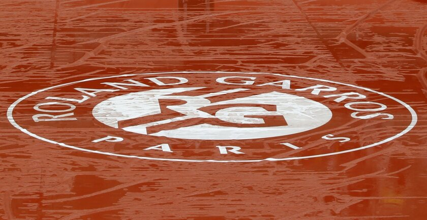 Puddles of rain water lie on the cover of center court of the French Open tennis tournament at the Roland Garros stadium in Paris, France, Monday, May 30, 2016. French Open organizers have announced the cancellation of all matches Monday at Roland Garros because of persistent rain forecast to last