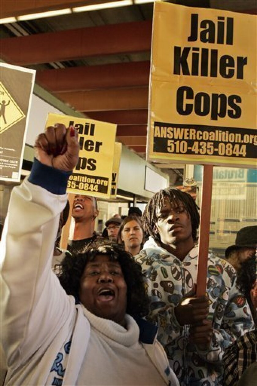 Protesters yell during a demonstration against the shooting death of Oscar Grant at the Fruitvale BART station in Oakland, Calif., Wednesday, Jan. 7, 2009. Grant was shot and killed by a police officer after an altercation on a BART train station platform in Oakland on New Year's Day.  (AP Photo/Ma