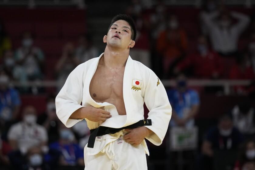 Shohei Ono of Japan reacts after winning the men's -73kg judo final match against Lasha Shavdatuashvili of Georgia, at the 2020 Summer Olympics in Tokyo, Japan, Monday, July 26, 2021. (AP Photo/Vincent Thian)