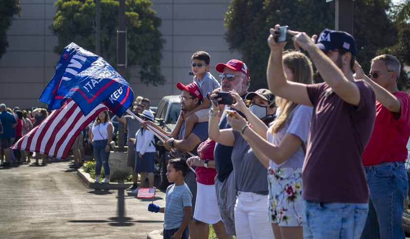 Supporters cheer President Trump as he departs from Orange County's John Wayne Airport on Oct. 18.