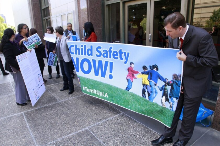 Social workers and activists who testified before Los Angeles County's Blue Ribbon Commission on Child Protection are seen demonstrating at the Hall of Administration in downtown L.A.