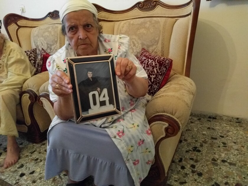 Mona Salman holds a photo of her niece, Noor Salman, the widow of Orlando gunman Omar Mateen. The aunt was photographed in her home in the West Bank on June 16, 2016.