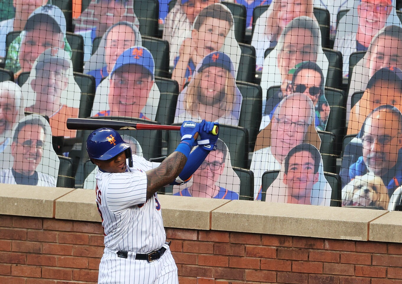 NEW YORK, NEW YORK - JULY 18: Yoenis Cespedes #52 of the New York Mets stands in the on deck circle in front of cardboard fans during their Pre Season game at Citi Field on July 18, 2020 in New York City. (Photo by Al Bello/Getty Images)