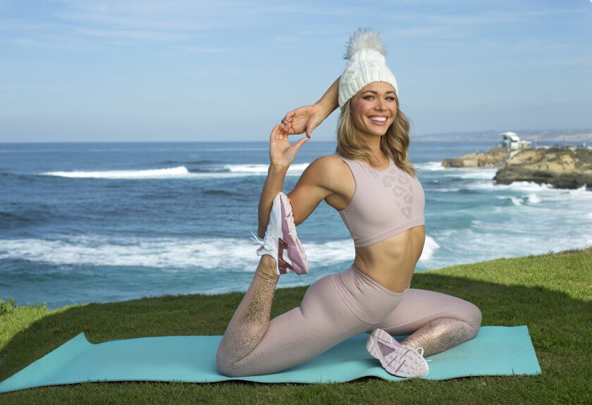 "Former ""Bachelor"" and ""Bachelor in Paradise"" participant Krystal Nielson in La Jolla. She is wearing a Varley rose sports bra, $68; Beyond Yoga metallic detail pants, $110, all Nordstrom Fashion Valley, and Echo knit hat $99 from Bloomingdales Fashion Valley."