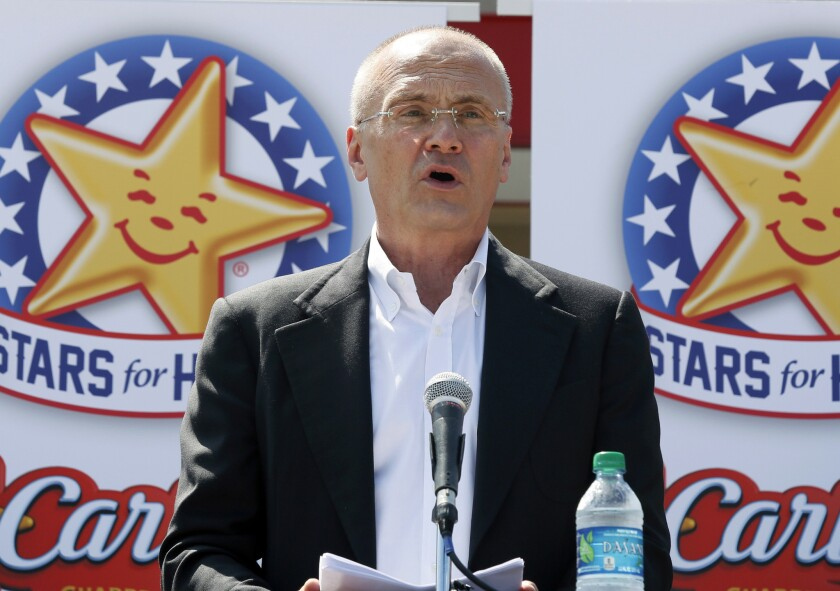 Andy Puzder, chief executive of CKE Restaurants Inc., speaks at a news conference in Austin, Texas, in 2014.