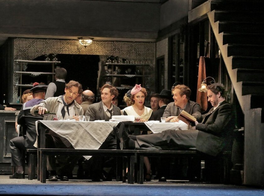 "In the San Diego Opera's production of ""La Boheme,"" Baritone Morgan Smith is Marcello (from left), tenor Harold Meers is Rodolfo, soprano Alyson Cambriidge is Mimi, baritone Malcolm MacKenzie is Schaunard, and bass bartitone Christian Van Horn is Colline. Photo: Ken Howard."