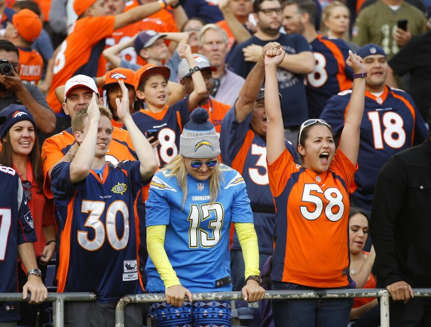 SAN DIEGO, CA -DEC. 6, 2015 -  Chargers fan Courtney LeVasseur braves a sea of Broncos fans during a 17-3 loss at Qualcomm Stadium. (K.C. Alfred/ San Diego Union-Tribune)