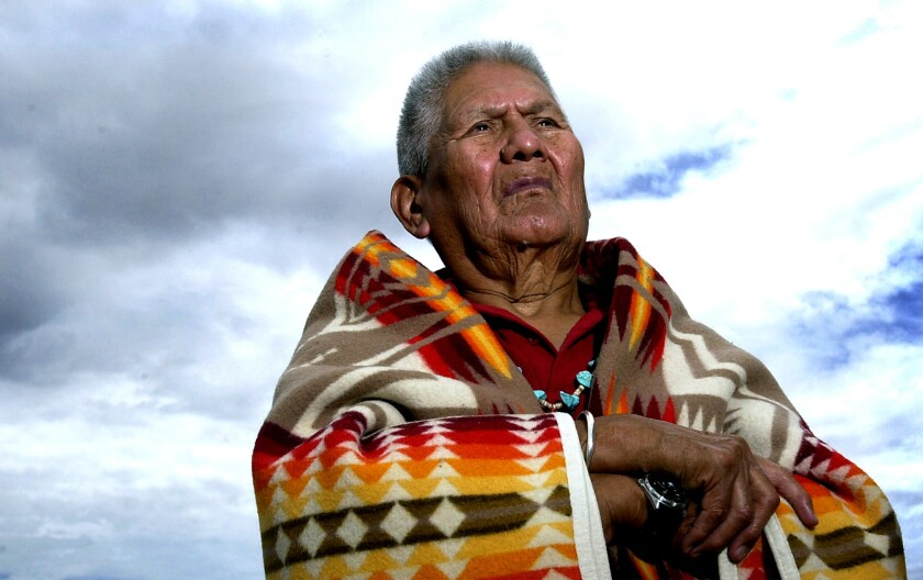 Chester Nez, the last of the Navajo code talkers, stands outside his son's home in Albuquerque in 2001.