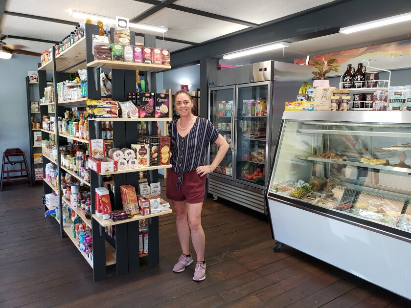 Owner Lisa Kennedy poses in The Corner Mercantile & Eatery, her La Jolla Shores grocery store/deli that opened at 8080 La Jolla Shores Drive earlier this year.