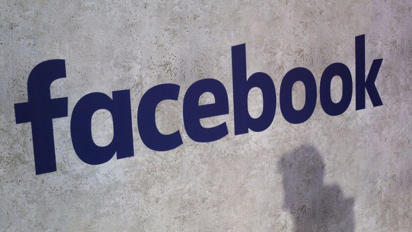 FILE - This Jan. 17, 2017, file photo shows a Facebook logo displayed in a start-up companies gather