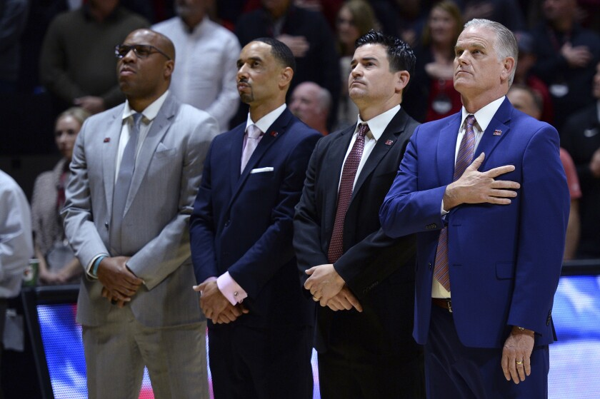 Assistant coach Jay Morris (second from left) has been hired by USC.