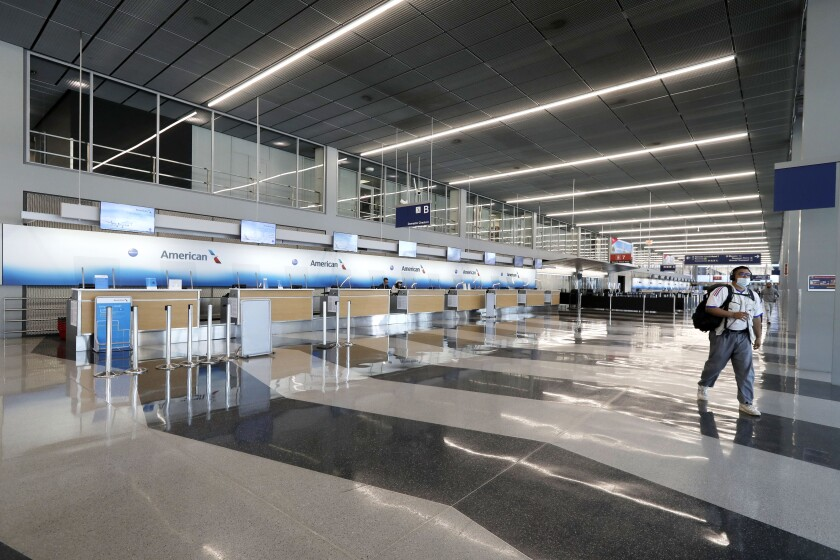 The American Airlines ticket counters at Chicago's O'Hare International Airport are empty on June 16.