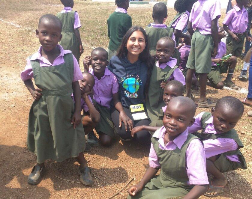 CCA student Shawdi Amini with children in Kenya.