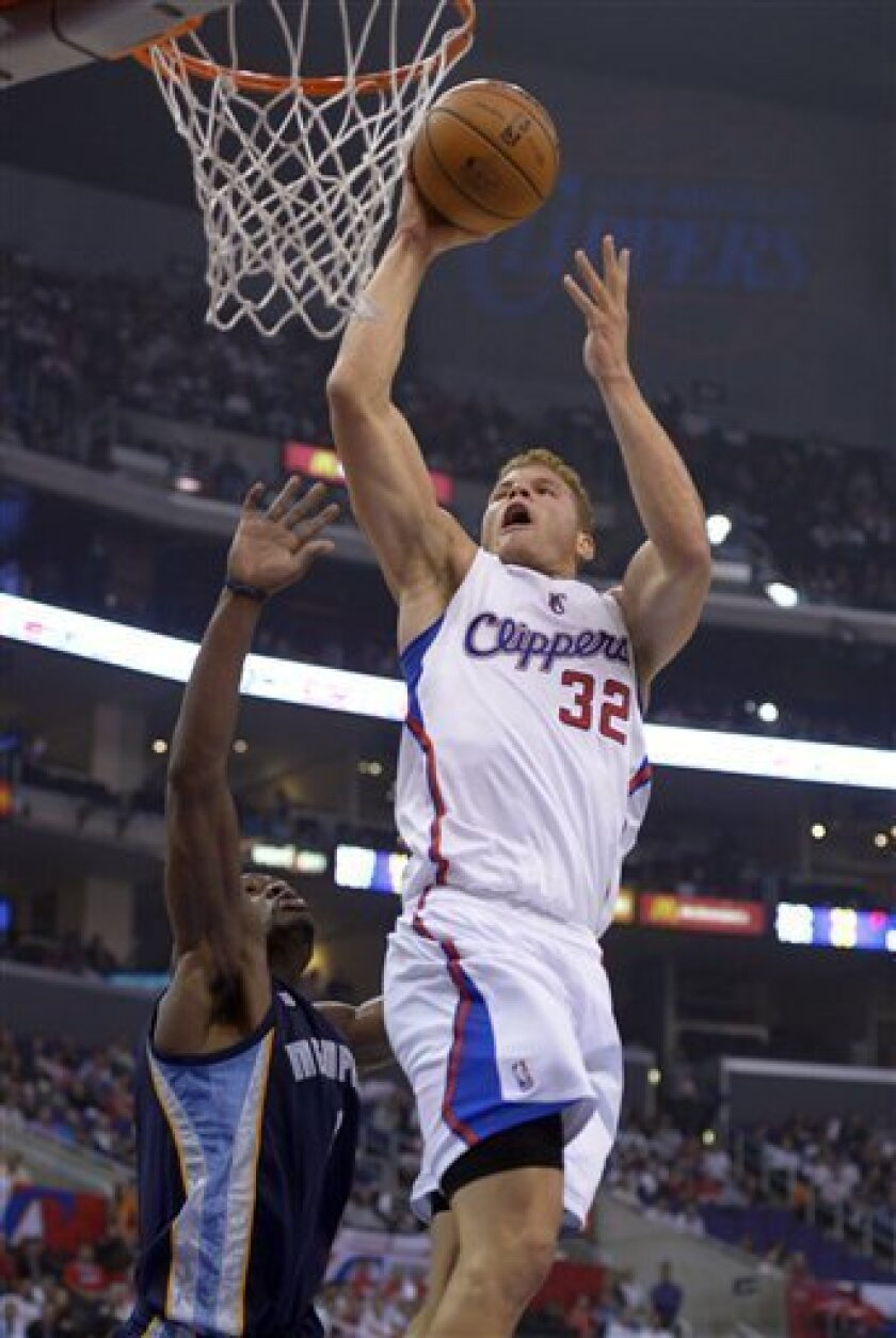 Los Angeles Clippers forward Blake Griffin, right, goes up for a dunk as Memphis Grizzlies guard Tony Allen defends during the first half of their NBA basketball, Wednesday, Oct. 31, 2012, in Los Angeles. (AP Photo/Mark J. Terrill)