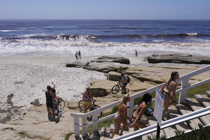 Saturday's warm weather brought out moderate crowds to take advantage of the beaches at Windansea in San Diego.