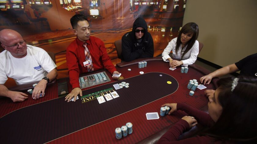 Thompson Pham, of The Casino Institute, deals a game of Texas Hold 'em, which requires skill and an