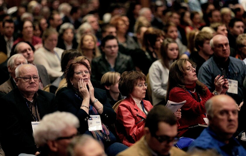 Kitty Nalewaik, of Knoxville, Md., second from left, reacts while listening to former U.S. Sen. Jim DeMint during the Conservative Political Action Conference outside Washington, D.C.