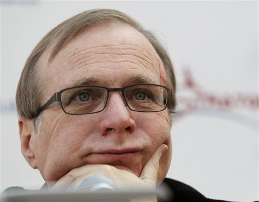 FILE - In this Dec. 13, 2011 photo, Microsoft co-founder Paul Allen listens during a a news conference in Seattle.   An AWOL soldier's simple scheme to defraud one of the richest men in the world has landed him in federal custody, according to a criminal complaint. In the complaint unsealed Monday,