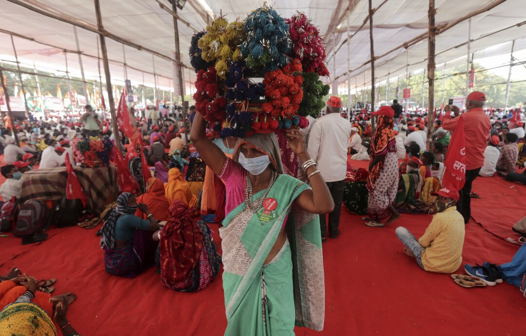 Farmers gather in Mumbai to press the Indian government to suspend contentious agricultural reform laws.