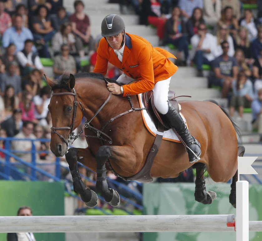 Jeroen Dubbeldam of the Netherlands, riding Zenith SFN during the 4th round of the individual qualifying show jumping event at the FEI World Equestrian Games in Caen, western France, Saturday, Sept. 6, 2014. The games end on Sunday. Jeroen Dubbeldam of the Netherlands is qualified for the Final 4 on Sunday with Patrice Delaveau of France, Rolf-Goeran Bengstsson of Sweden and Beezi Madden of the United States. (AP Photo/Michel Euler)
