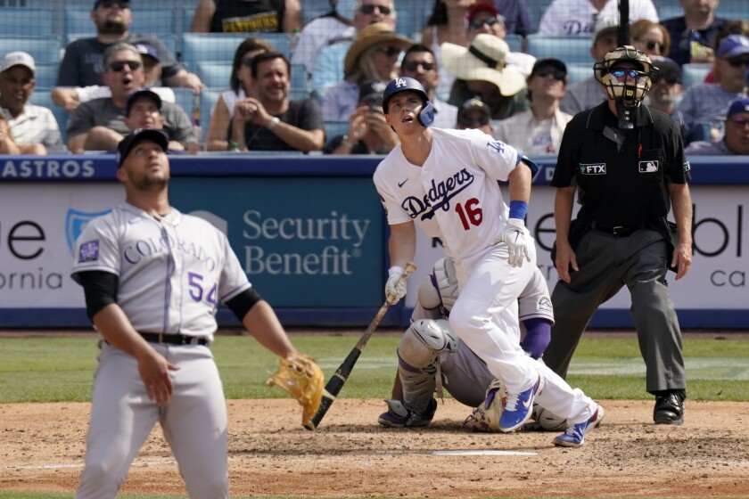 The Dodgers' Will Smith watches the flight of his home run as he leaves the batter's box.