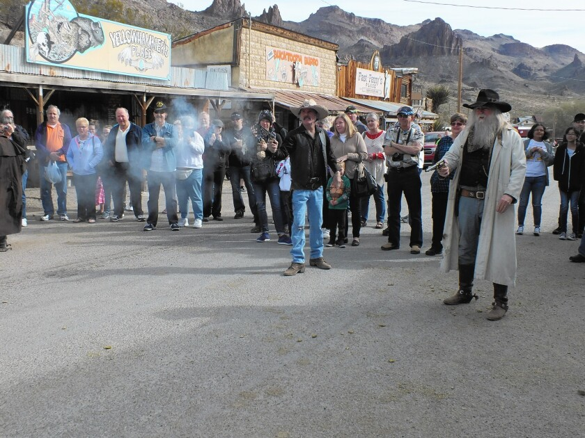 A mock gunfight draws spectators in tiny Oatman, Ariz., where the Old West meets the new and burros roam free.