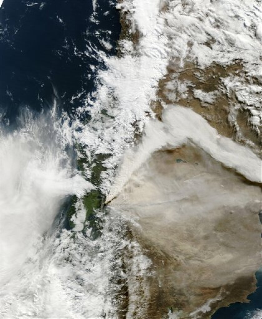 This natural-color satellite image provided by NASA was acquired by the Moderate Resolution Imaging Spectroradiometer (MODIS) aboard Terra satellite on the morning of June 6, 2011 of the Puyehue-Cordon Caulle eruption in Chile. At the time the Buenos Aires Volcanic Ash Advisory Center reported that the ash plume reached an altitude of 40,000 feet (12,000 meters). A shift in prevailing winds has cause the kink in the volcanic plume. (AP Photo/NASA)