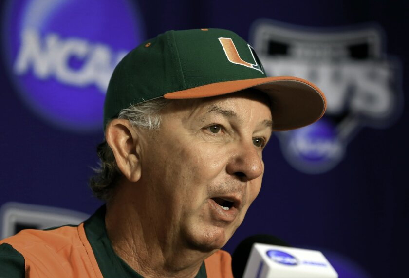 FILE - In this June 12, 2015, file photo, Miami coach Jim Morris speaks during a coaches news conference at the NCAA College World Series in Omaha, Neb. It was a big weekend for Miami, and not just because the men's basketball team reached the NCAA Sweet 16. Baseball coach Jim Morris recorded his 1