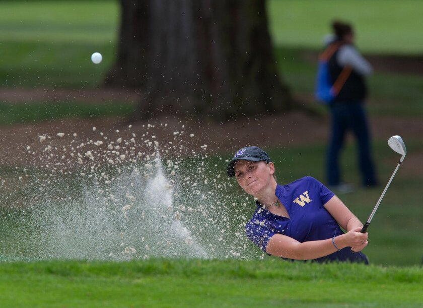 Washington's Charlotte Thomas blasts out of a bunker on the 1st hole during the final round of the NCAA Division I women's golf championships at Eugene Country Club in Eugene, Ore. Wednesday, May 25, 2016. (Brian Davies/The Register-Guard via AP) MANDATORY CREDIT