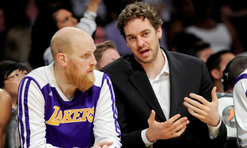 Chris Kaman, left, and Pau Gasol had plenty of time to catch up on the bench during the Lakers' 115-99 win over the Phoenix Suns on March 30.