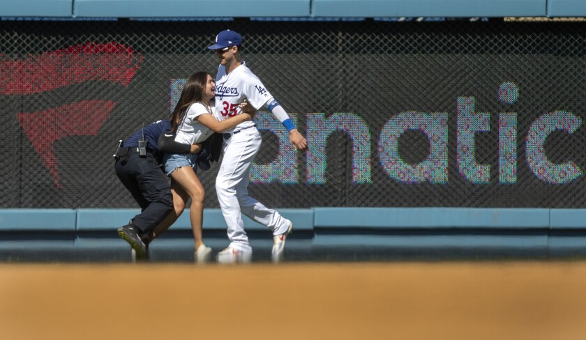 Dodgers outfielder Cody Bellinger has been approached on the field by female fans during the last two games.