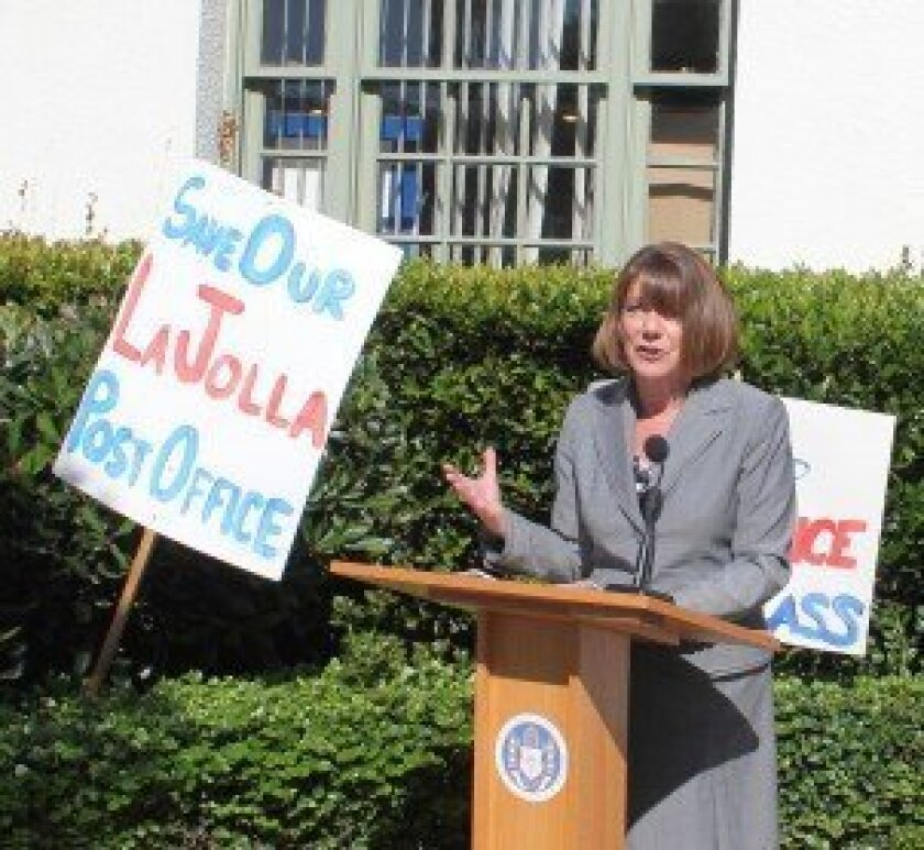 Congresswoman Susan Davis spoke outside the Wall Street post office this month, following the San Diego City Council's unanimous support of her legislation aimed at allowing community groups a head start at purchasing their historic post offices. Pat Sherman photos