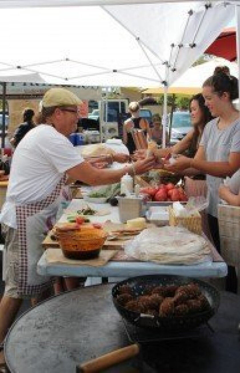 Thyme of Essence serves up wraps at the farmers market. Photo by Karen Billing