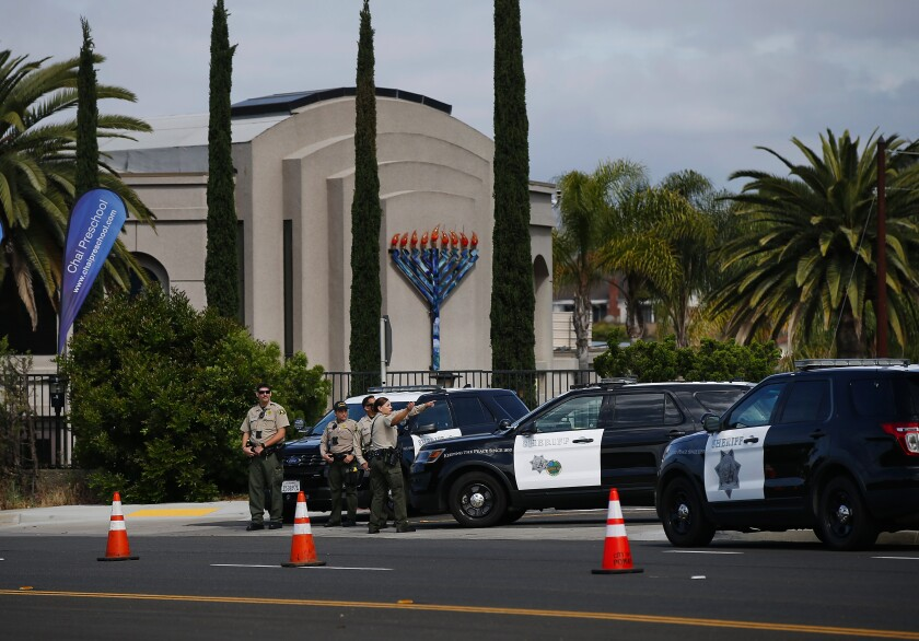 Sheriff's deputies stand outside the Chabad of Poway synagogue in April after a deadly shooting