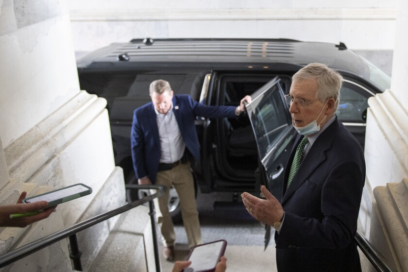 Senate Majority Leader Mitch McConnell talks to reporters at the Capitol on Monday.