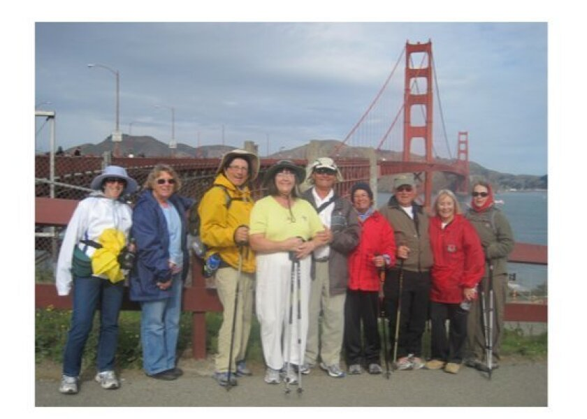 At the approach to the Golden Gate Bridge are, from left, Beverly Tenke, Joanna Brown, Marshal Taylor, Ann and Nick Haritatos, Leila Taylor, Ron Williamson, Yvonne Hanson, and Elizabeth Hansen. Courtesy Photo