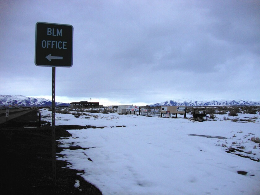 """Protesting ranchers have pitched their """"Cowboy Grass Camp"""" on a muddy roadside across from the BLM's district office in Battle Mountain, Nev."""