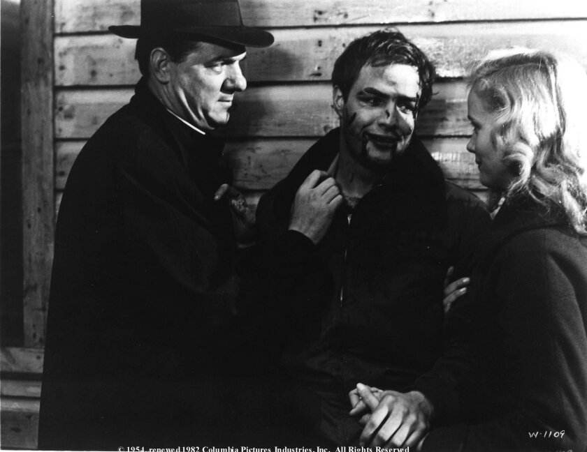"""Karl Malden (left) was nominated for an Oscar when he appeared with Marlon Brando and Eva Marie Saint in director Elia Kazan's """"On the Waterfront"""" in 1954. (Columbia Pictures)"""
