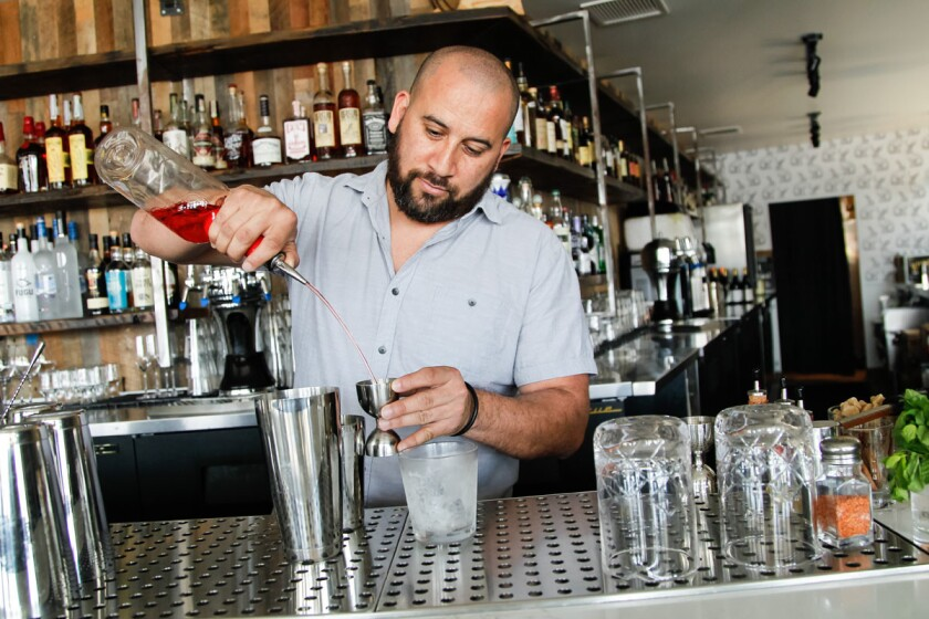 Beverage manager Juan Sanchez makes a drink at Hundred Proof | (Eduardo Contreras/Union-Tribune)