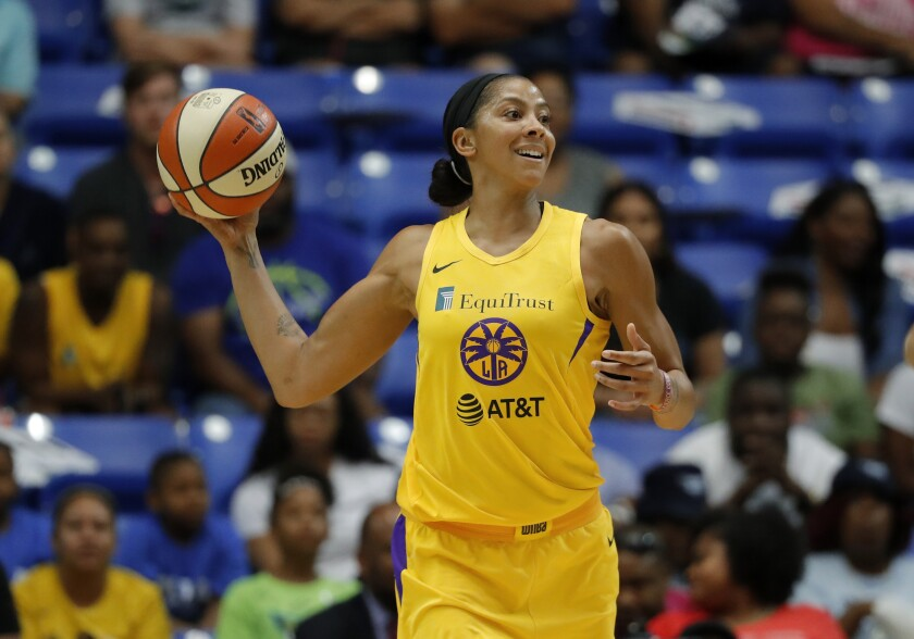 Sparks' Candace Parker makes a pass during a game against the Dallas Wings.