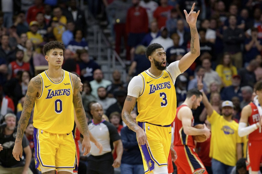 Lakers forward Anthony Davis (3) celebrates alongside teammate Kyle Kuzma after making his final free throw to seal the Lakers' 114-110 defeat of the Pelicans on Nov. 27 in New Orleans.
