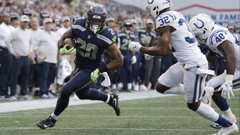 Seattle Seahawks running back Rashaad Penny rushes past Indianapolis Colts defensive back T.J. Green (32) during a preseason game on Aug. 9.